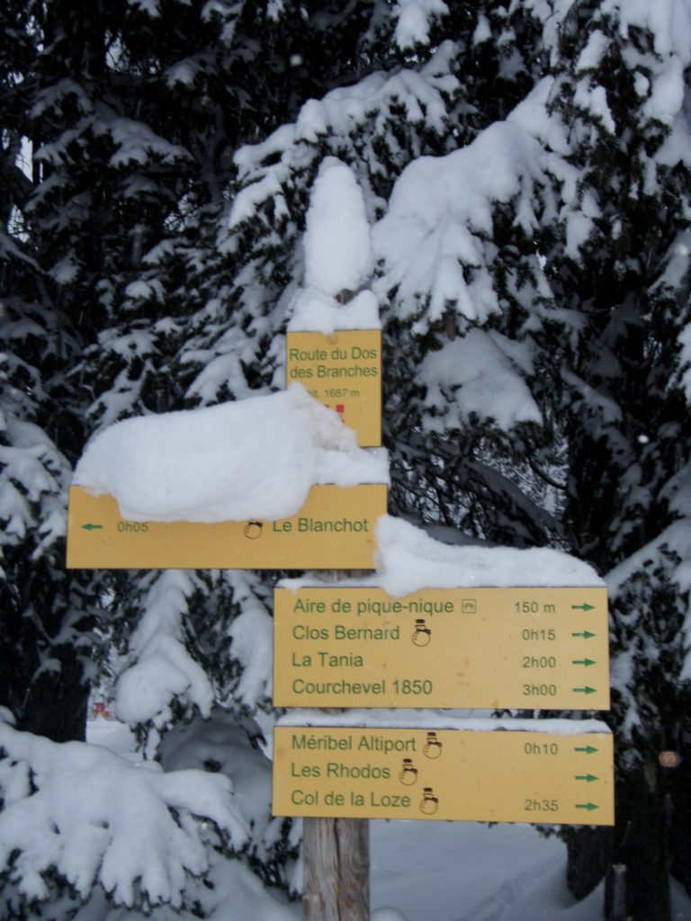 Walking direction sign Meribel in winter